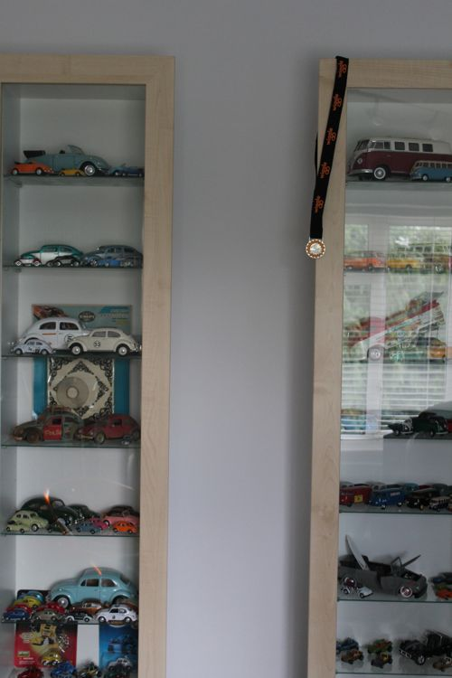 Rob's collection of VW toys and a medal he won on a 50 mile bike ride last weekend.