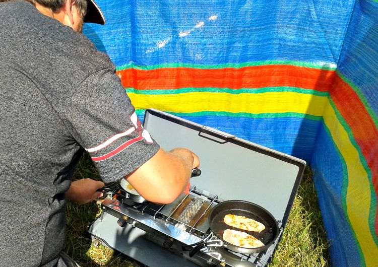 Another snap of our camping set up. Rob cooking something greasy for breakfast!